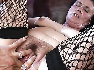 Clad In Black Stuff And Fishnet Stuff Matures Whore Marianna Is Fucked